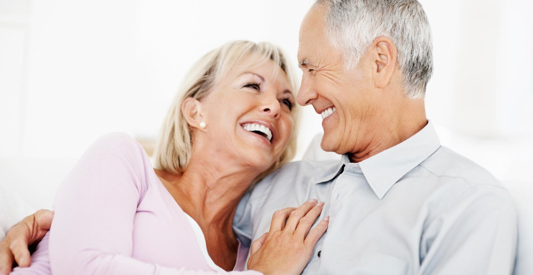 A senior couple laughing together