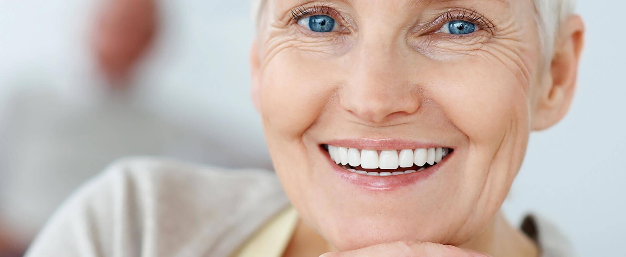 A senior lady smiling with her new dentures