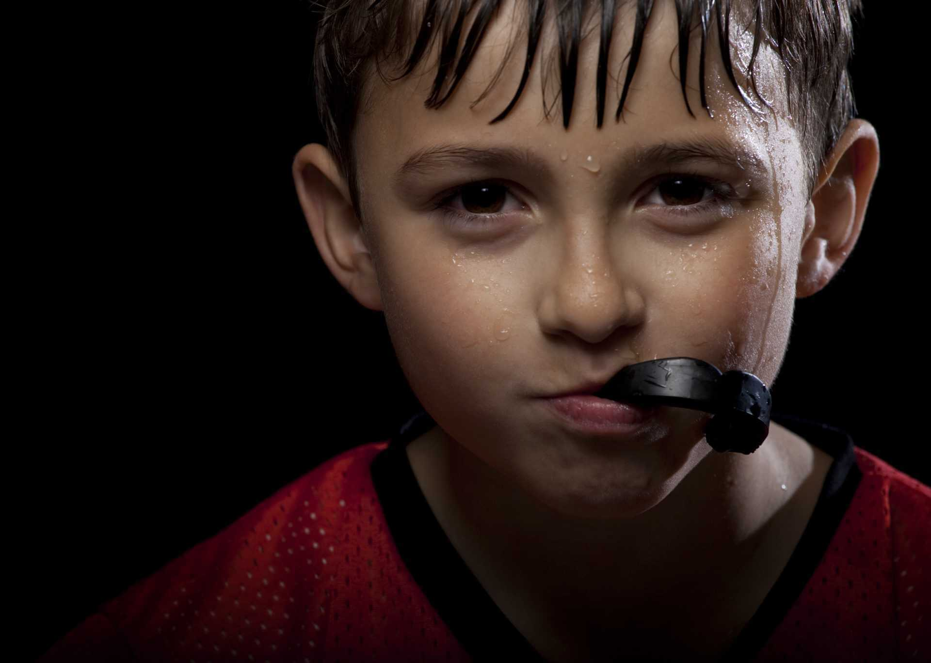 A child wearing custom mouth guards during sport