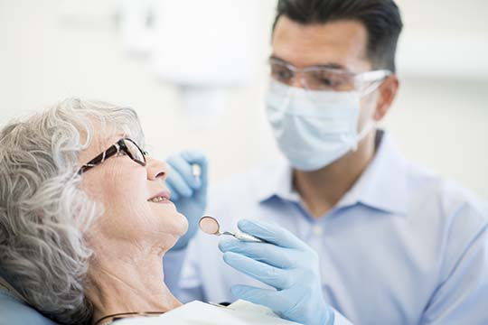 A woman getting dentures at a denture clinic