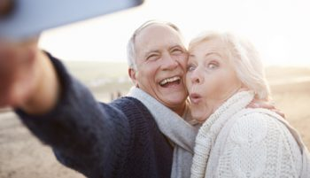 A senior couple taking a selfie on a holiday