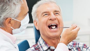 A man getting his dentures repaired